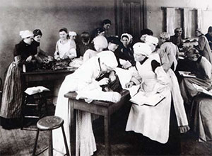"Female medical students, referred to at the time as ""hen medics,"" perform anatomy dissections, circa 1893. Male and female students had separate dissection rooms until 1908."