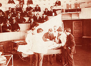 George Dock (center, in suit) demonstrates clinical technique to an amphitheater full of students in 1898.