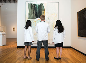 Trisha Paul, Stephen Riutta, and Ting Gou discuss Joan Mitchell's painting White Territory.
