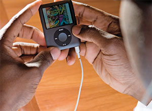 iPods are just one new tool available to residents in today's fast-paced training programs. Here, resident Shawn Hervey-Jumper views a podcast from the journal Neurosurgery.