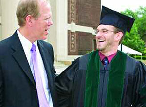 Jim Hays visits with Adam Possner on the steps of Hill Auditorium at commencement in June 2006. The James C. Hays, M.D., Scholarship helped support Possner, who graduated first in his class, through his four years of medical study.
