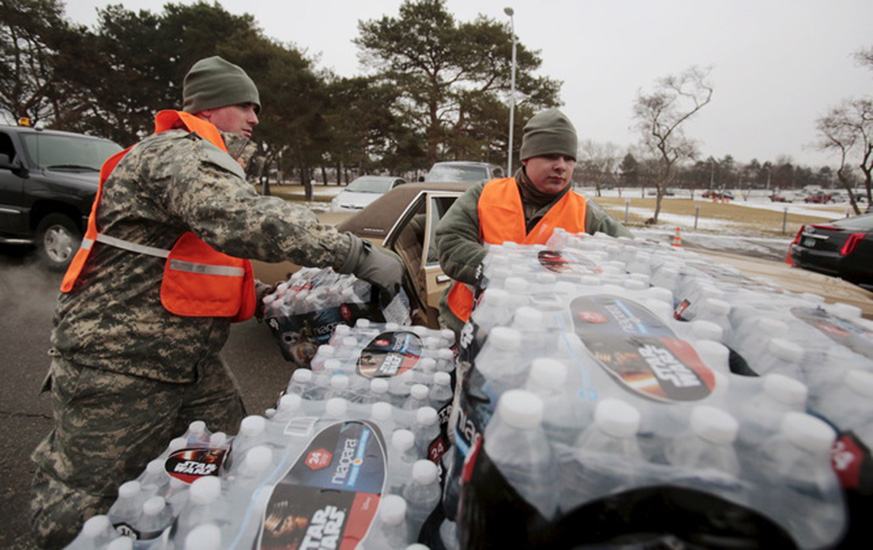handing out water bottles