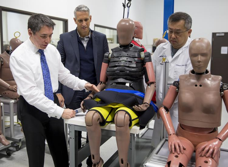 Experts in the lab with crash-test dummies