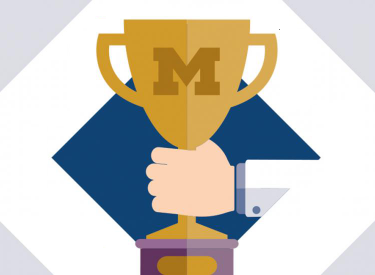Illustration of trophy with block M