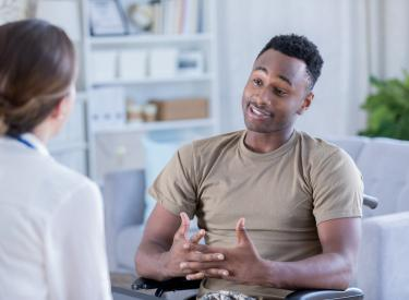 Soldier talking to doctor therapist