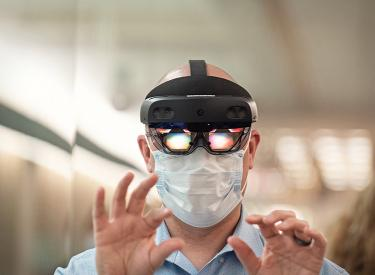 person wearing virtual reality goggles